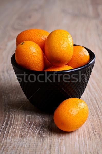 Maduro laranja mentiras pote preto Foto stock © zia_shusha