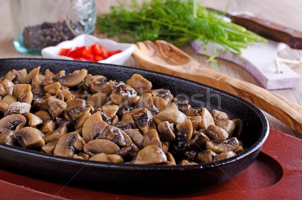 Grzyby posiekane gotowany patelnia żywności gotowania Zdjęcia stock © zia_shusha
