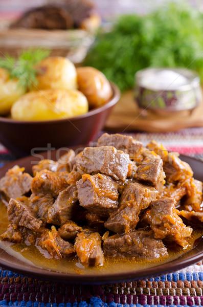 Stoven stukken vlees geserveerd rustiek stijl Stockfoto © zia_shusha