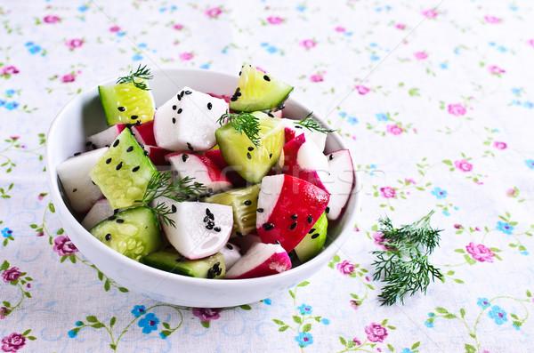 Salad of radish and cucumber  Stock photo © zia_shusha