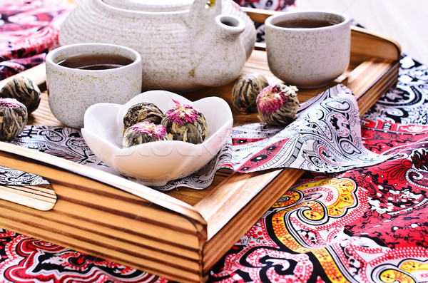 Green tea in the form of a ball with a red flower Stock photo © zia_shusha