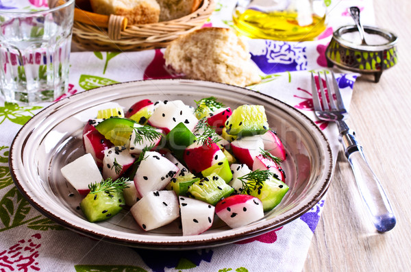 Salad of radish and cucumber Stock photo © zia_shusha