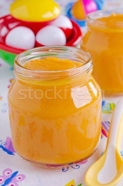 Baba táplálkozás bébiétel narancs szín üveg Stock fotó © zia_shusha