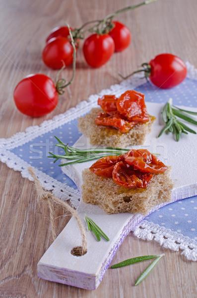 Tomates sol secas comida madeira Foto stock © zia_shusha