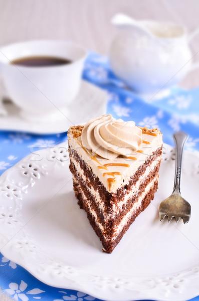 Kahverengi kek krem kesmek parça plaka Stok fotoğraf © zia_shusha