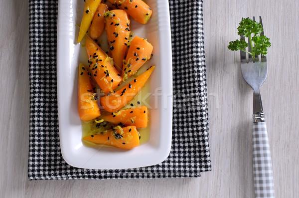 Acompanhamento cenouras bebê preto garfo Foto stock © zia_shusha