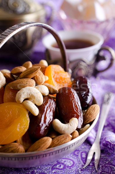 almonds, dried apricots, cashews, dates, lying in a metal bowl  Stock photo © zia_shusha