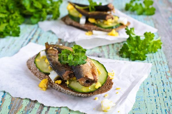 Sandviç balık küçük füme salatalık yumurta Stok fotoğraf © zia_shusha