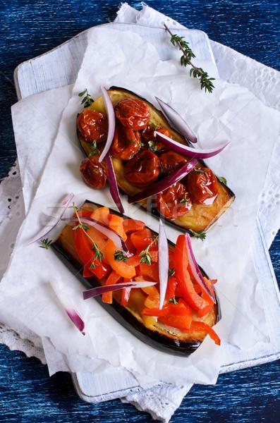 Berinjela legumes metade jantar tomates Foto stock © zia_shusha