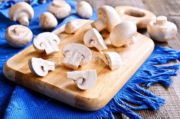 Champignon champignons geheel houten oppervlak Stockfoto © zia_shusha