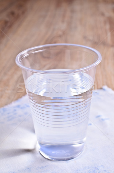 Transparent liquid in a plastic Cup Stock photo © zia_shusha