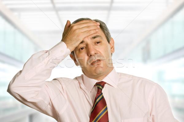 Baş ağrısı işadamı ofis el adam Stok fotoğraf © zittto
