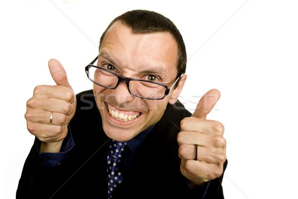 Dom jonge zakenman spelen geïsoleerd witte Stockfoto © zittto