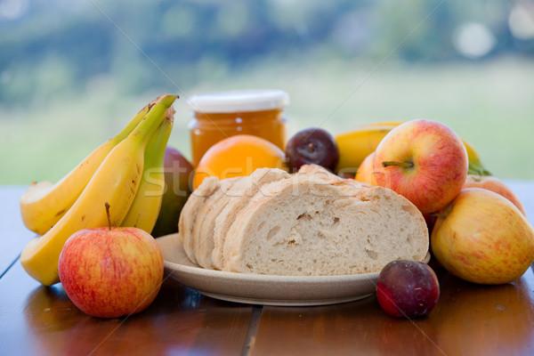 Meyve ekmek meyve bal tablo bahçe Stok fotoğraf © zittto