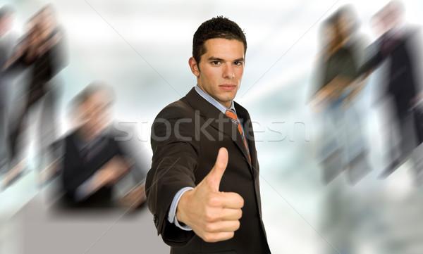 Pulgar hasta jóvenes hombre de negocios mano cara Foto stock © zittto