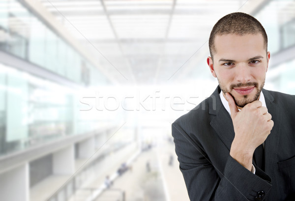 üzletember fiatal gondolkodik iroda férfi üzletember Stock fotó © zittto