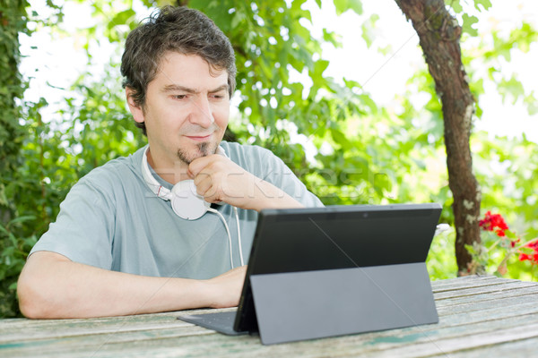 man with tablet Stock photo © zittto