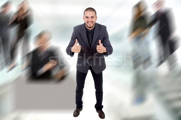 Genç iş adamı ofis gülümseme mutlu Stok fotoğraf © zittto