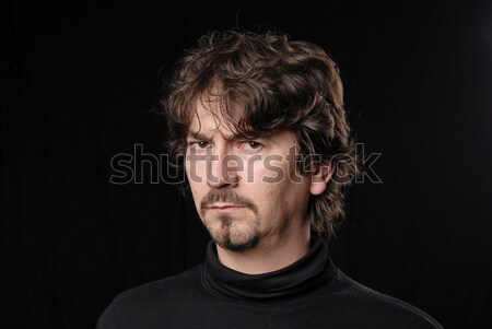 Dom jonge toevallig man portret zwarte Stockfoto © zittto