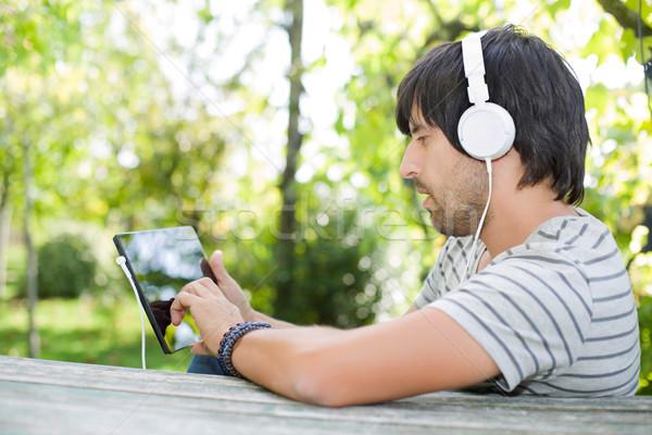 Adam çalışma genç dinleme müzik Stok fotoğraf © zittto