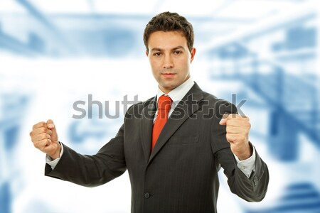 Stock fotó: Gondolkodik · fiatal · üzletember · asztal · iroda · üzlet