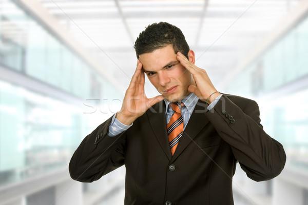 Dor de cabeça empresário gestos escritório negócio homem Foto stock © zittto
