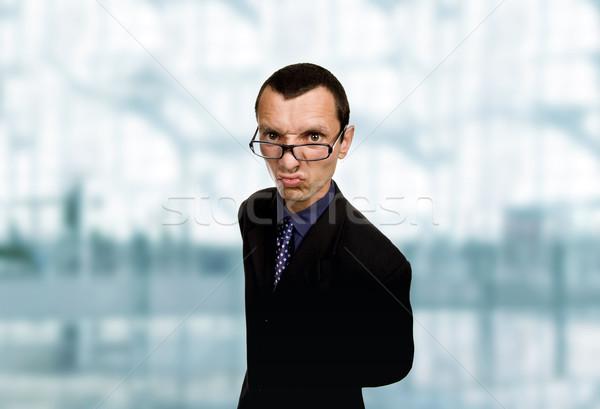 Zniekształcony młodych człowiek biznesu biuro działalności człowiek Zdjęcia stock © zittto