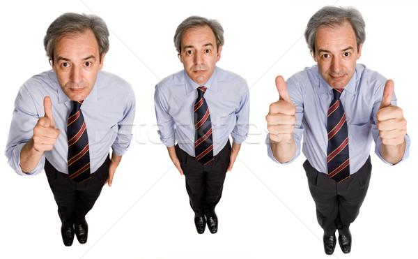 большой палец руки зрелый бизнесмен различный позиции изолированный Сток-фото © zittto