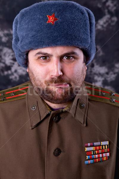 Szovjet fiatalember orosz katonaság stúdió piros Stock fotó © zittto