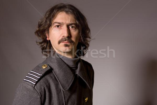 Orosz katonaság fiatalember piros retro kalap Stock fotó © zittto