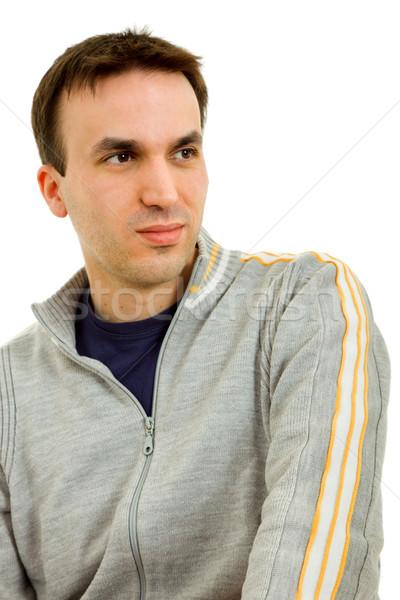 мышления студию фотография случайный молодым человеком изолированный Сток-фото © zittto