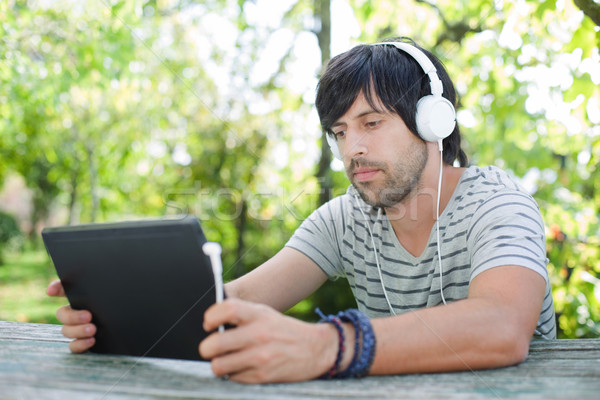 man working with tablet pc Stock photo © zittto