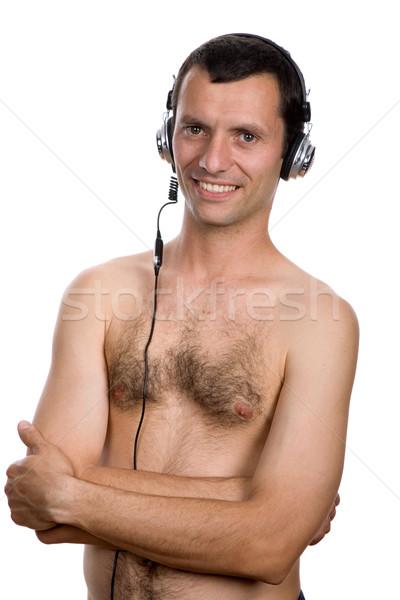 Música moço fones de ouvido isolado branco homem Foto stock © zittto
