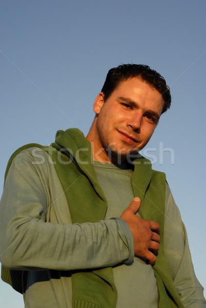 Erkek genç portre gökyüzü gün batımı ışık Stok fotoğraf © zittto
