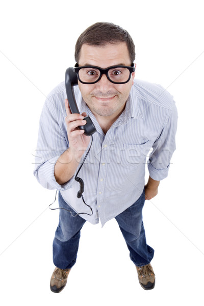 Stupido giovane telefono isolato bianco uomo Foto d'archivio © zittto