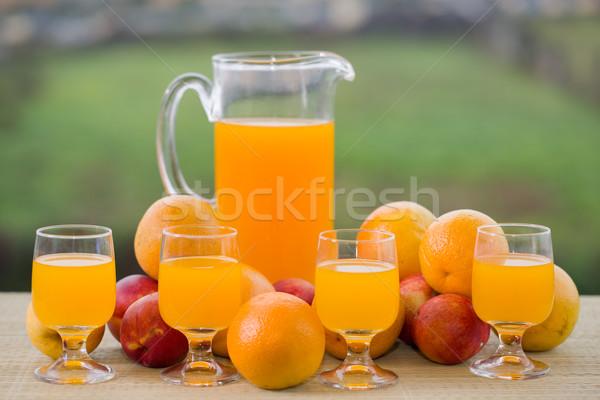 Portakal suyu gözlük meyve ahşap masa açık elma Stok fotoğraf © zittto