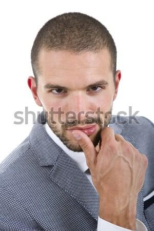 Denken jonge toevallig man geïsoleerd witte Stockfoto © zittto