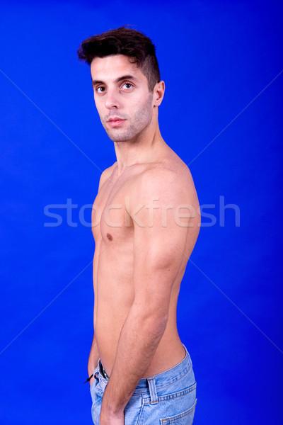 Topless człowiek młodych przypadkowy niebieski szczęśliwy Zdjęcia stock © zittto