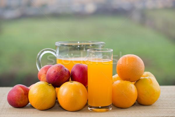 апельсиновый сок очки плодов деревянный стол Открытый яблоко Сток-фото © zittto