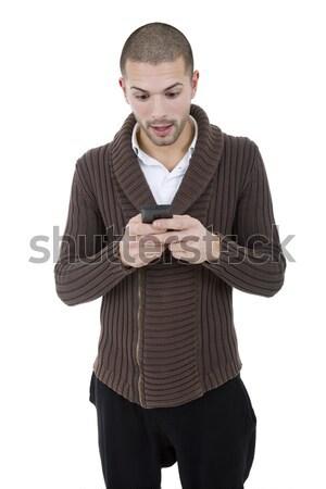 Sms üzenetküldés fiatal lezser férfi telefon sms chat Stock fotó © zittto