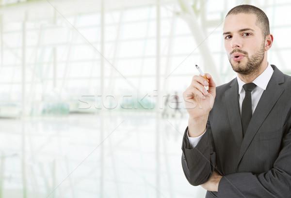 Dohányos üzletember dohányzás iroda férfi portré Stock fotó © zittto