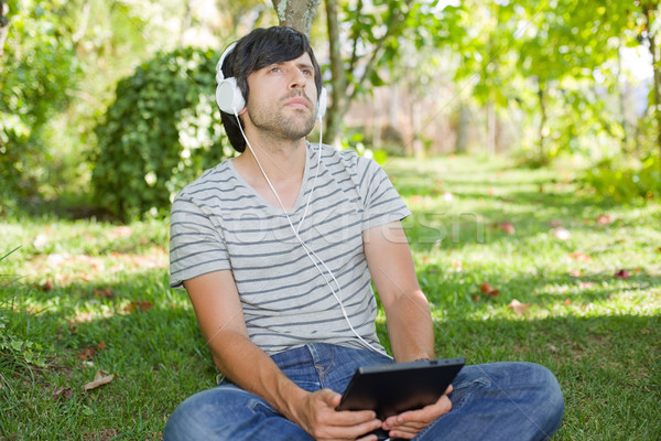 man relaxing with tablet pc Stock photo © zittto
