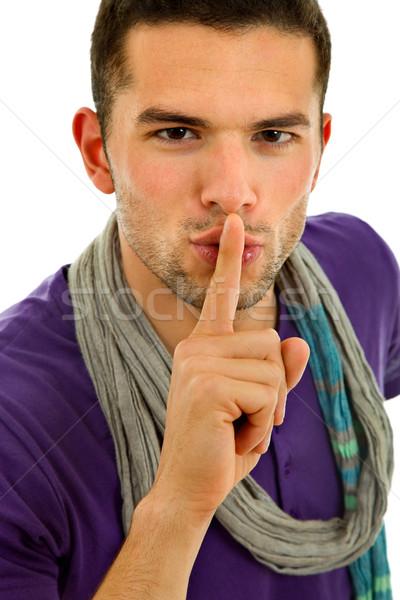 Stilte jonge man tonen gebaar vinger mond Stockfoto © zittto