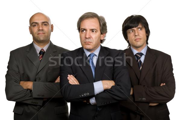 команда три деловых людей изолированный белый заседание Сток-фото © zittto