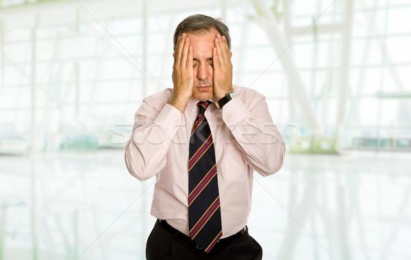 Dor de cabeça empresário terno gestos negócio escritório Foto stock © zittto