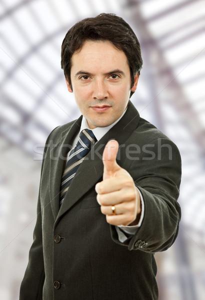 большой палец руки вверх молодые деловой человек служба бизнеса Сток-фото © zittto