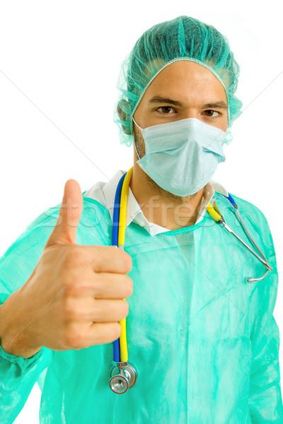 Duim omhoog jonge mannelijke arts geïsoleerd witte Stockfoto © zittto