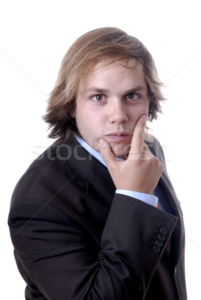 Fiatal üzletember gondolkodik fehér üzlet haj Stock fotó © zittto
