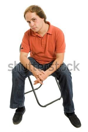 сидящий молодые случайный человека небольшой диван Сток-фото © zittto