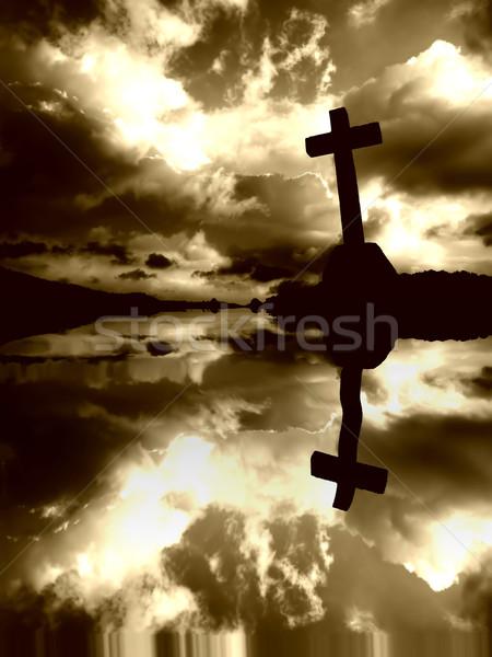 Kruis christelijke wolken water reflectie zonsondergang Stockfoto © zittto